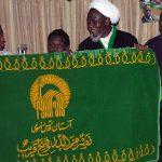اهدای پرچم متبرک بارگاه مطهر حضرت رضا علیه السلام به شیخ زکزاکی در زندان نیجریه